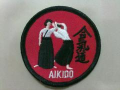 Emblema aikido em tecido